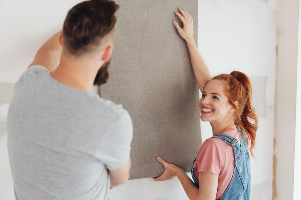 Couple choosing wallpaper